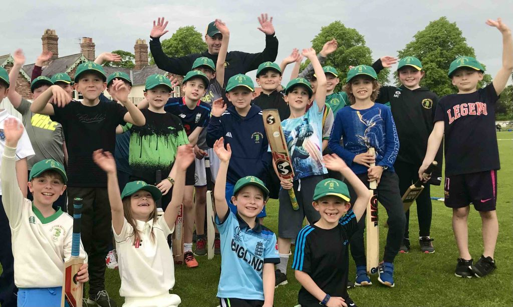 Ali Wray of A Wray Electrical with Clifton Alliance U9 cricketers in brand new hats